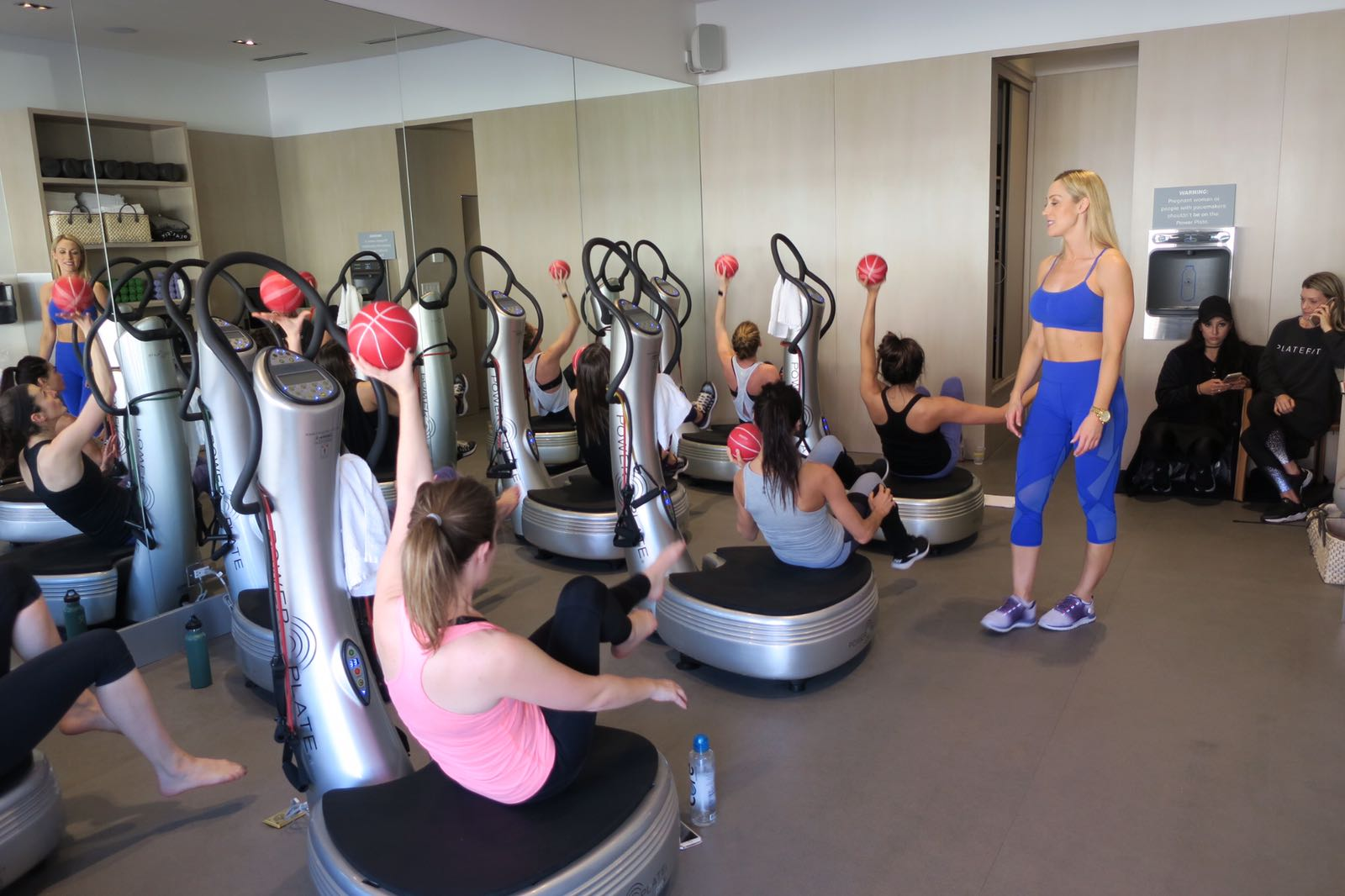 Caroline Pearce instructing Power Plate class at 'Train like a Gladiator' event